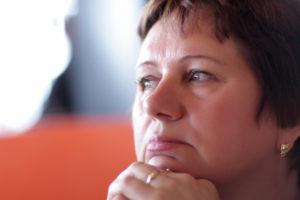 home care cordele ga Alzheimer's caregiver looking sad