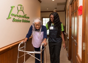 Client and caregiver walking the hallway