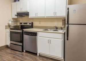 kitchen stove, dishwasher, sink and refrigerator